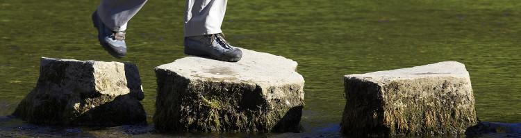 bigstock_Crossing_Three_Stepping_Stones_158564